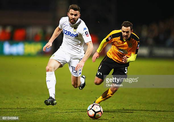Stuart Dallas of Leeds United is chased by Blair Adams of Cambridge United during the Emirates FA Cup Third Round match between Cambridge United and...