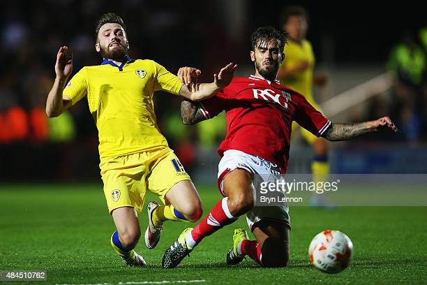 Stuart Dallas of Leeds United tackles Marlon Pack of Bristol City during the Sky Bet Championship match between Bristol City and Leeds United at...