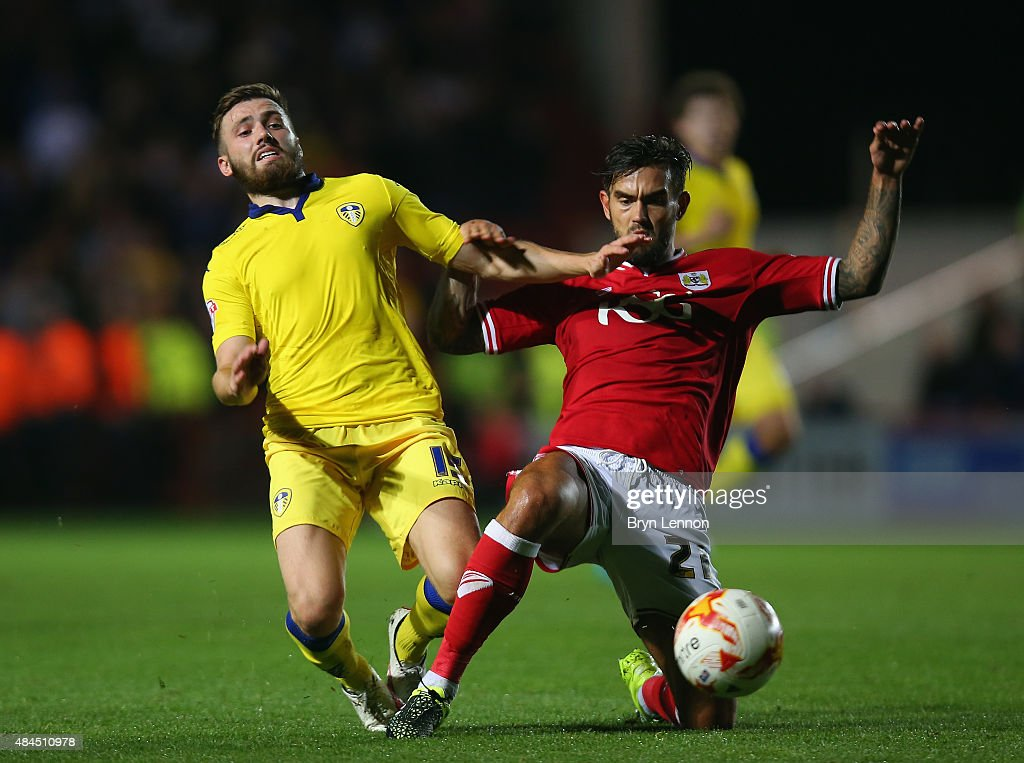 Stuart Dallas of Leeds United tackles Marlon Pack of Bristol City during the Sky Bet Championship match between Bristol City and Leeds United at Ashton Gate on August 19, 2015 in Bristol, England.