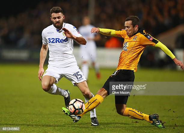 Stuart Dallas of Leeds United takes on Blair Adams of Cambridge United during the Emirates FA Cup Third Round match between Cambridge United and...