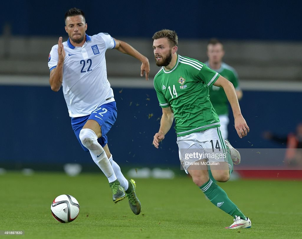 Stuart Dallas of Northern Ireland (R) and Andreas Samaris of Greece (L) during the Euro 2016 Group F international football match at Windsor Park on October 8, 2015 in Belfast, Northern Ireland.