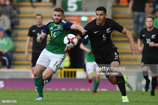 Stuart Dallas of Northern Ireland and Michael Boxall of New Zealand during the international friendly football match between Northern Ireland and New...