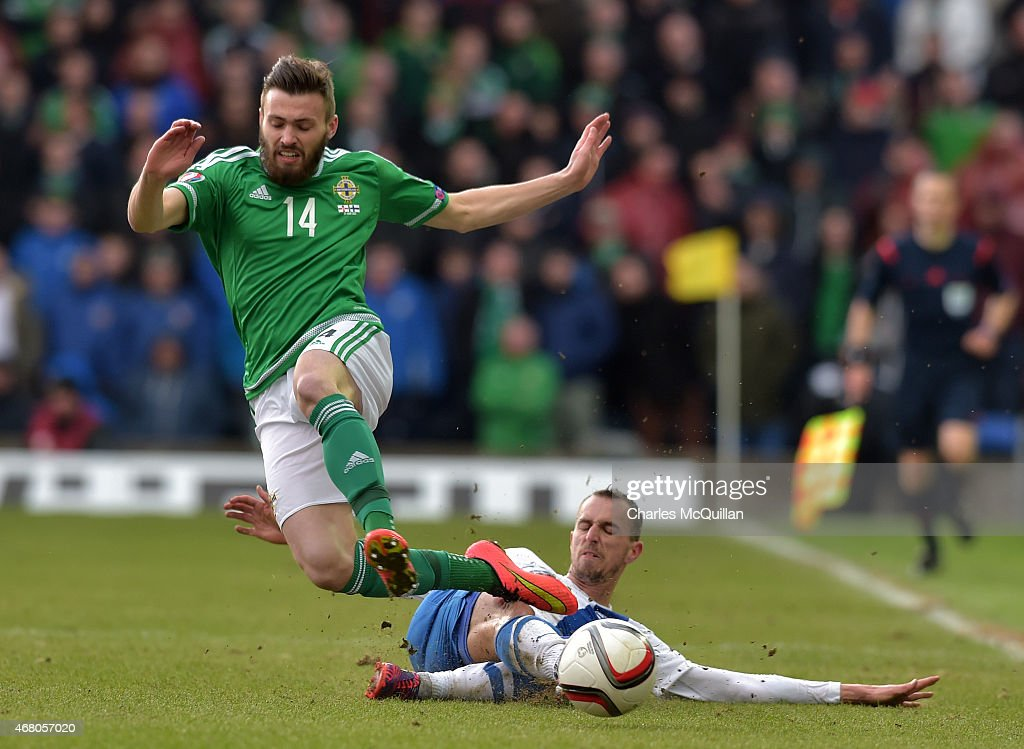 Stuart Dallas (L) of Northern Ireland and Sakari Mattila (R) of Finland during the EURO 2016 Group F qualifier at Windsor Park on March 29, 2015 in Belfast, Northern Ireland.