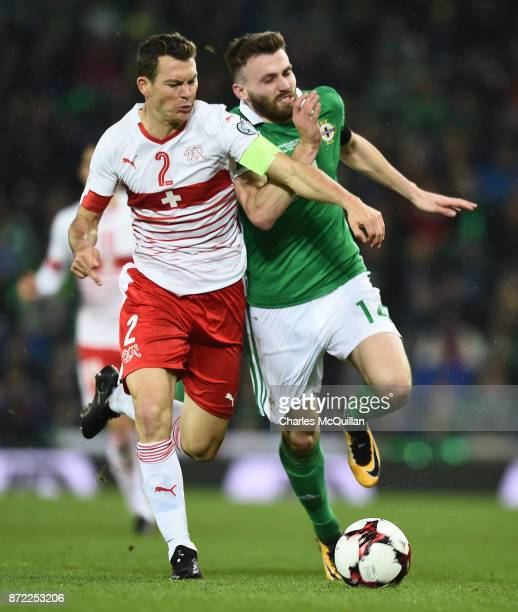 Stuart Dallas of Northern Ireland and Stephan Lichtsteiner of Switzerland during the FIFA 2018 World Cup Qualifier PlayOff first leg between Northern...