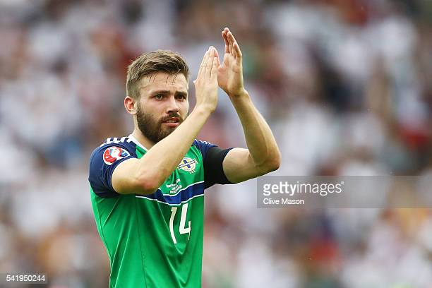 Stuart Dallas of Northern Ireland applauds the supporters after his team's 01 defeat in the UEFA EURO 2016 Group C match between Northern Ireland and...
