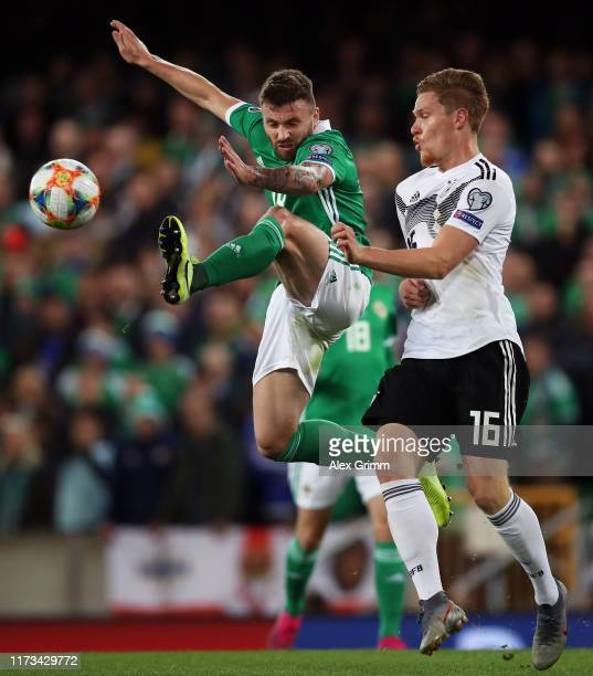 Stuart Dallas of Northern Ireland is challenged by Marcel Halstenberg of Germany during the UEFA Euro 2020 qualifier match between Northern Ireland...