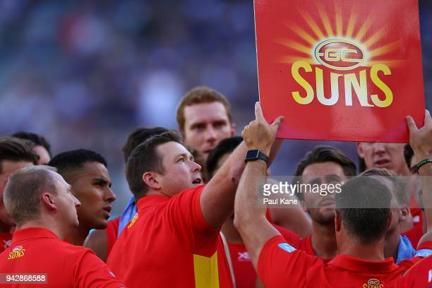 Stuart Dew coach of the Suns addresses his players at the quarter time break during the round three AFL match between the Gold Coast Suns and the...