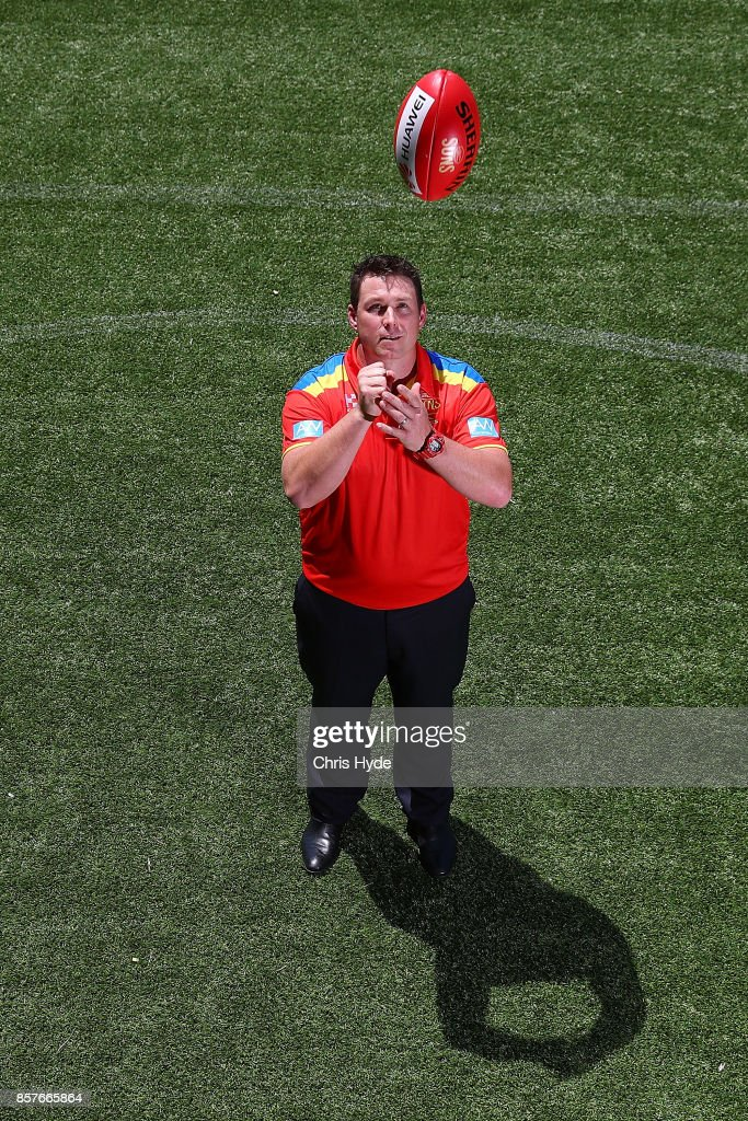 Stuart Dew poses after being appointed Senior Coach during a Gold Coast Suns AFL press conference at their training facility on October 5, 2017 in Gold Coast, Australia.