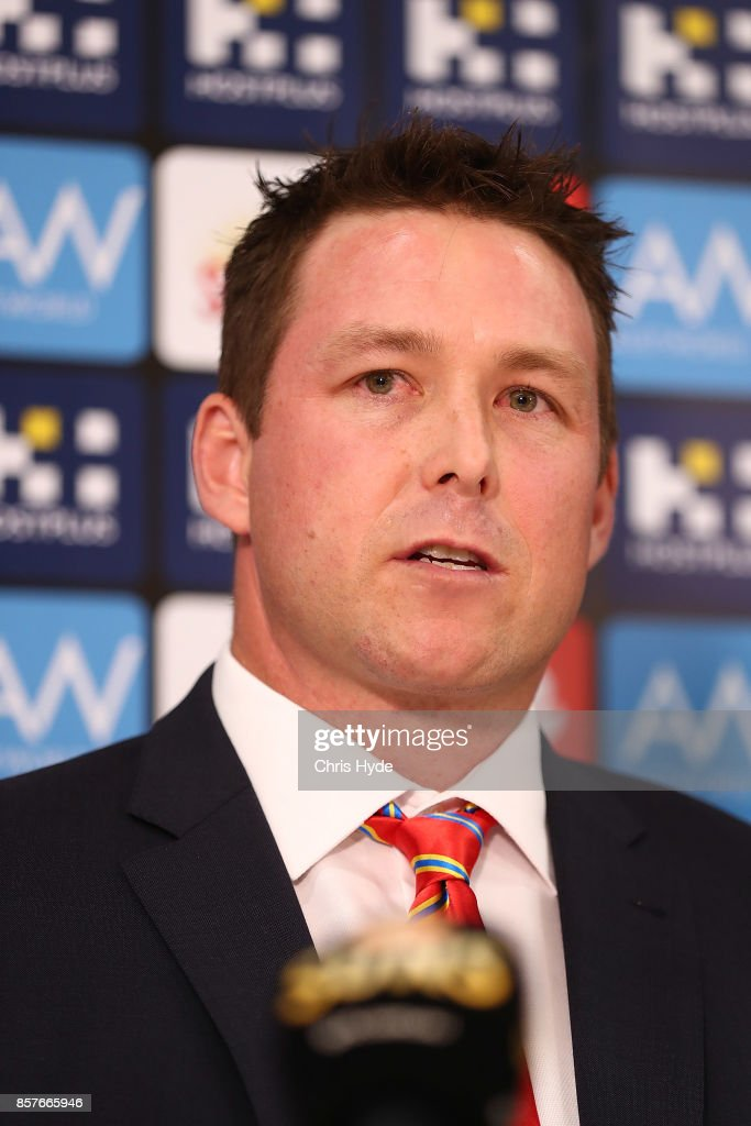 Stuart Dew speaks to the media after being appointed Senior Coach during a Gold Coast Suns AFL press conference at their training facility on October 5, 2017 in Gold Coast, Australia.