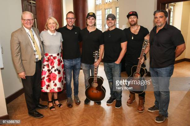 Stuart Dill Elizabeth Roff Tommy Moore Ross Copperman Jon Nite Kip Moore and Shawn McSpadden attend the ACM Lifting Lives Music Camp Songwriting...