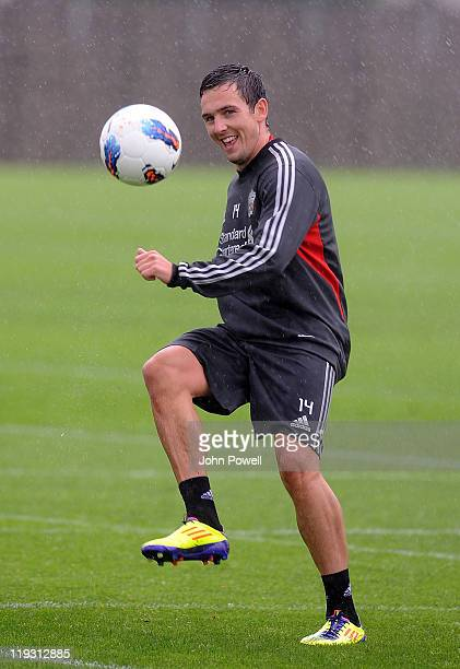 Stuart Downing of Liverpool in action duringa training session at Melwood training ground on July 18 2011 in Liverpool England