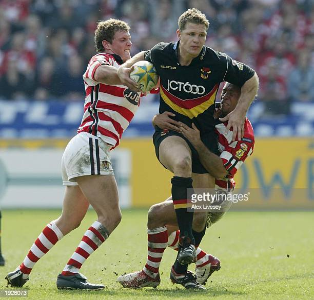 Stuart Fielden of Bradford Bulls is tackled by Sean O'Loughlin and Adrian Lam of Wigan Warriors during the Powergen Challenge Cup SemiFinal match...