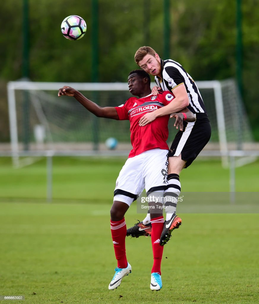 Stuart Findlay of Newcastle (6) wins a header from Elijah Adebayo of Fulham (9) during the Premier League 2 Match between Newcastle United and Fulham at Whitley Park on April 10, 2017 in Newcastle upon Tyne, England.