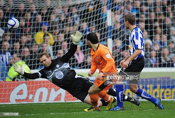 Stuart Fleetwood of Hereford United shoots past Sheffield Wednesday goalkeeper Nicky Weaver to score during the FA Cup sponsored by E.On 4th Round...