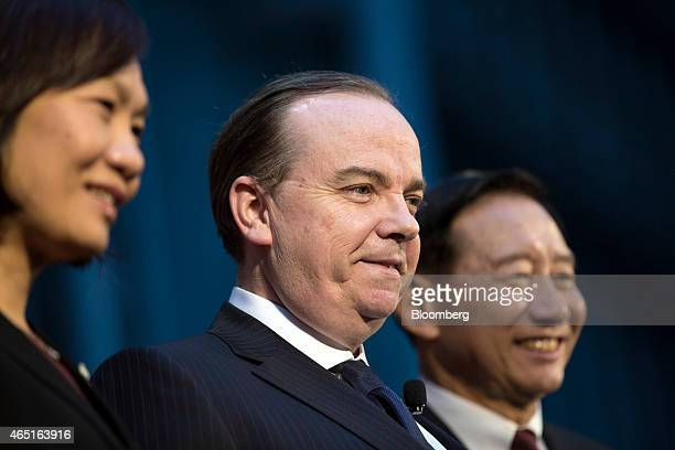 Stuart Gulliver chief executive officer of HSBC Holdings Plc center Helen Wong chief executive officer of HSBC Holdings Plc's Greater China...