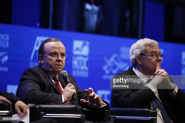 Stuart Gulliver chief executive officer of HSBC Holdings Plc left speaks as Jean Lemierre chairman of BNP Paribas SA looks on during a panel...