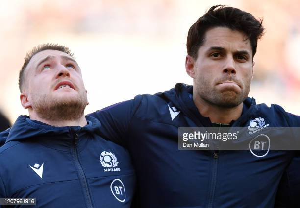 Stuart Hogg and Sean Maitland of Scotland line up for the national anthem prior to the 2020 Guinness Six Nations match between Italy and Scotland at...