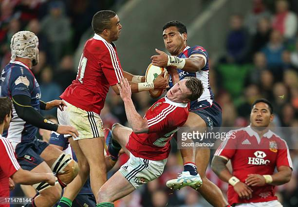 Stuart Hogg and Simon Zebo of the Lions contest a high ball with Cooper Vuna of the Rebels during the International Tour Match between the Melbourne...