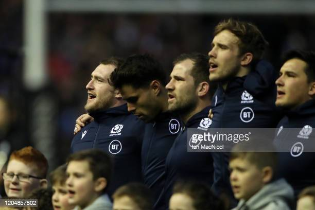Stuart Hogg and teammates sing the Scottish National Anthem during the 2020 Guinness Six Nations match between Scotland and England at Murrayfield on...