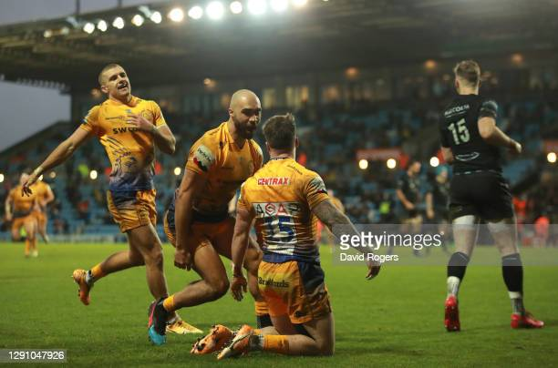 Stuart Hogg of Exeter Chiefs celebrates after scoring their third try with Olly Woodburn and Henry Slade during the Heineken Champions Cup Pool 2...