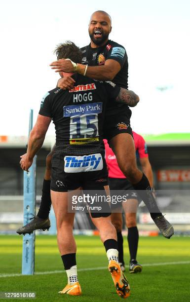 Stuart Hogg of Exeter Chiefs celebrates scoring a try with team mate Tom O'Flaherty during the Gallagher Premiership Rugby first semifinal match...