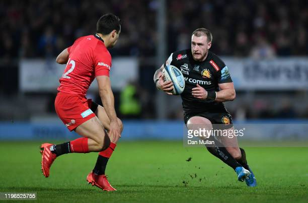 Stuart Hogg of Exeter Chiefs takes on Alex Lozowski of Saracens during the Gallagher Premiership Rugby match between Exeter Chiefs and Saracens at...