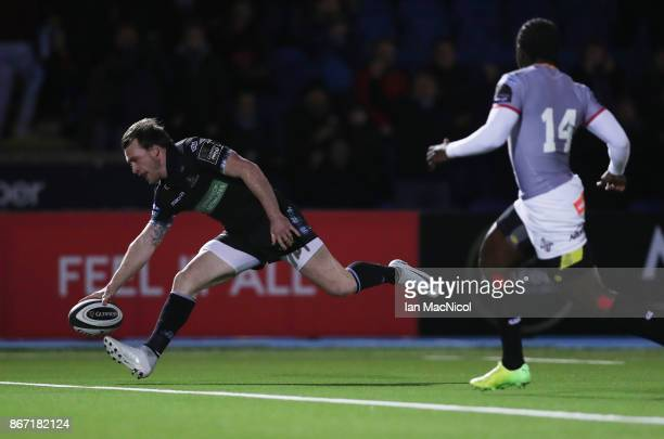 Stuart Hogg of Glasgow Warriors scores the opening try during the Glasgow Warriors and Southern Kings Guinness Pro 14 match at Scotstoun Stadium on...