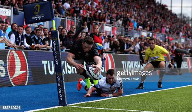 Stuart Hogg of Glasgow Warriors stops Chris Ashton of Saracens from scoring a try during the European Rugby Champions Cup match between Saracens and...