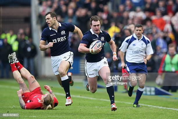Stuart Hogg of Scotland breaks away to score the opening try during the RBS Six Nations match between Scotland and Wales at Murrayfield Stadium on...