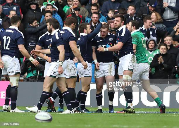 Stuart Hogg of Scotland celebrates after he scores the opening try during the RBS 6 Nations match between Scotland and Ireland at Murrayfield Stadium...