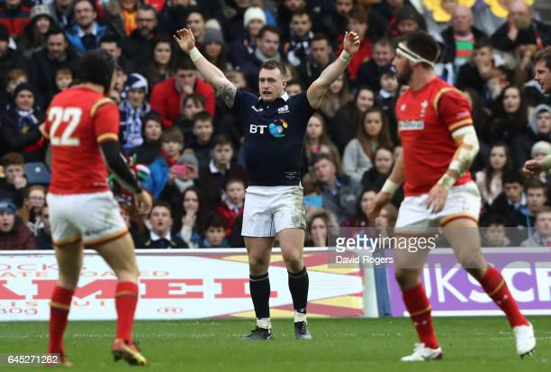 Stuart Hogg of Scotland celebrates his team's 29-13 victory as the final whistle blows during the RBS Six Nations match between Scotland and Wales at...