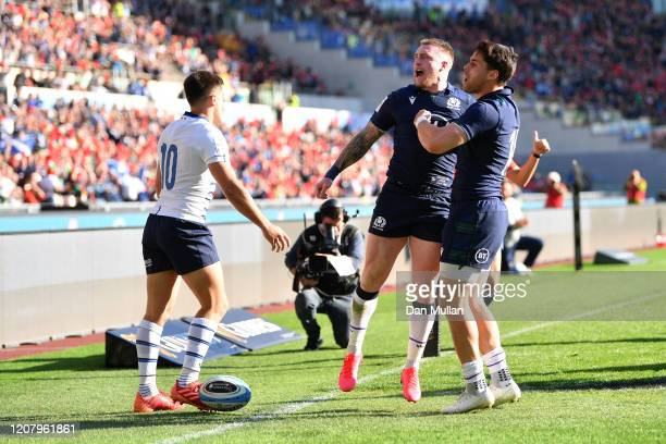 Stuart Hogg of Scotland celebrates scoring his sides first try with Sean Maitland during the 2020 Guinness Six Nations match between Italy and...