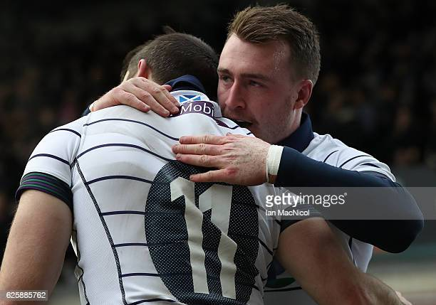 Stuart Hogg of Scotland congratulates Tommy Seymour of Scotland after he scores his team's first try during the Autumn Test Match between Scotland...