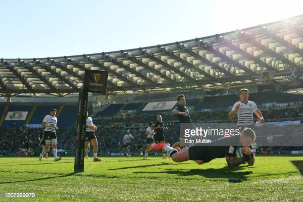 Stuart Hogg of Scotland goes over to score his sides first try during the 2020 Guinness Six Nations match between Italy and Scotland at Stadio...