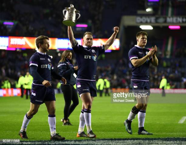 Stuart Hogg of Scotland holds the trophy aloft after victory in the NatWest Six Nations match between Scotland and England at Murrayfield on February...