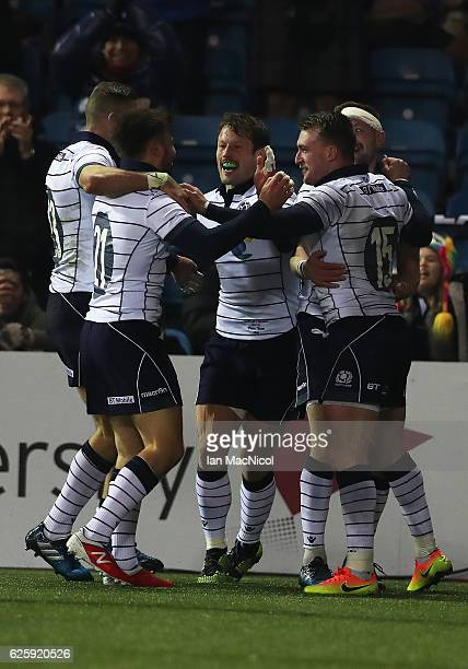 Stuart Hogg of Scotland is congratulated by team mates after he scores the sixth Scotland try during the Autumn Test Match between Scotland and...