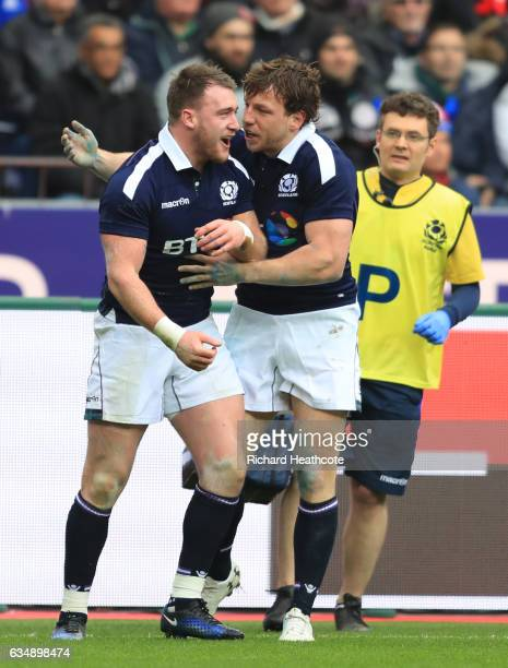 Stuart Hogg of Scotland is congratulated by teammate Hamish Watson after scoring the opening try during the RBS Six Nations match between France and...