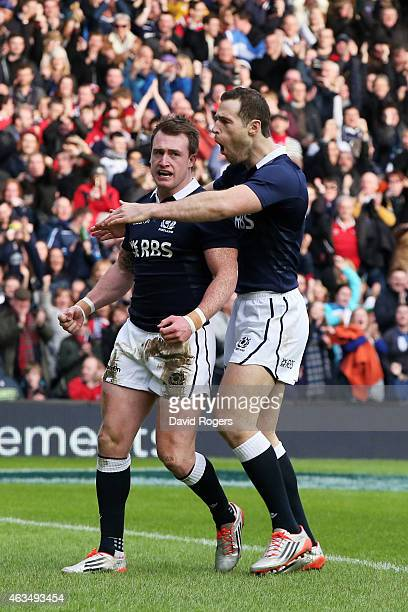Stuart Hogg of Scotland is congratulated by Tim Visser of Scotland after scoring the opening try during the RBS Six Nations match between Scotland...