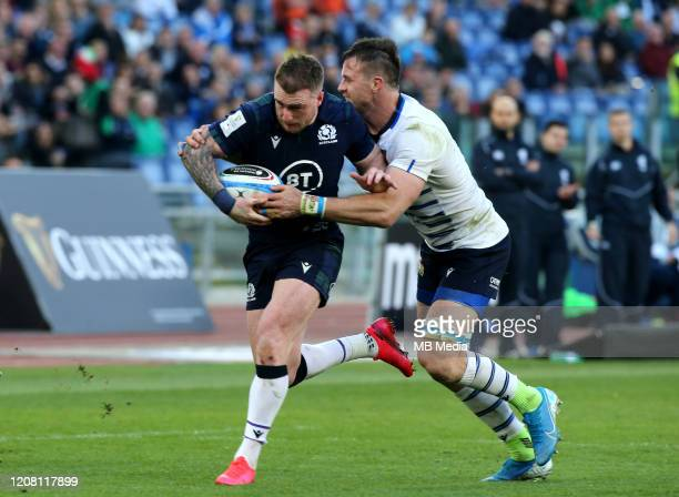 Stuart Hogg of Scotland is tackled by Abraham Steyn of Italy during the 2020 Guinness Six Nations match between Italy and Scotland at Stadio Olimpico...