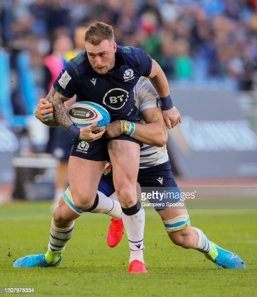 Stuart Hogg of Scotland is tackled during the 2020 Guinness Six Nations match between Italy and Scotland at Stadio Olimpico on February 22 2020 in...