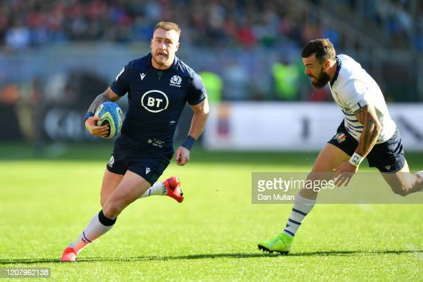 Stuart Hogg of Scotland makes a break prior to scoring his sides first try during the 2020 Guinness Six Nations match between Italy and Scotland at...