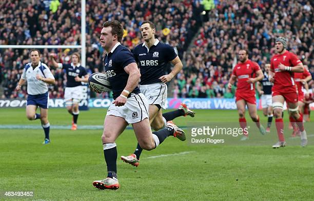Stuart Hogg of Scotland runs in the opening try during the RBS Six Nations match between Scotland and Wales at Murrayfield Stadium on February 15,...
