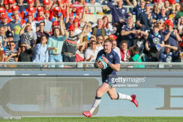 Stuart Hogg of Scotland runs to scores a try during the 2020 Guinness Six Nations match between Italy and Scotland at Stadio Olimpico on February 22...