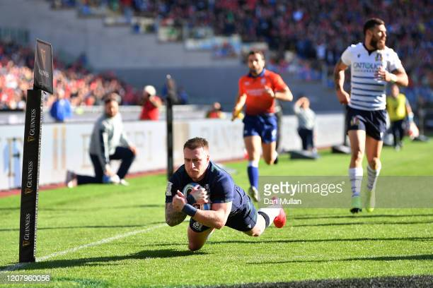 Stuart Hogg of Scotland scores his sides first try during the 2020 Guinness Six Nations match between Italy and Scotland at Stadio Olimpico on...