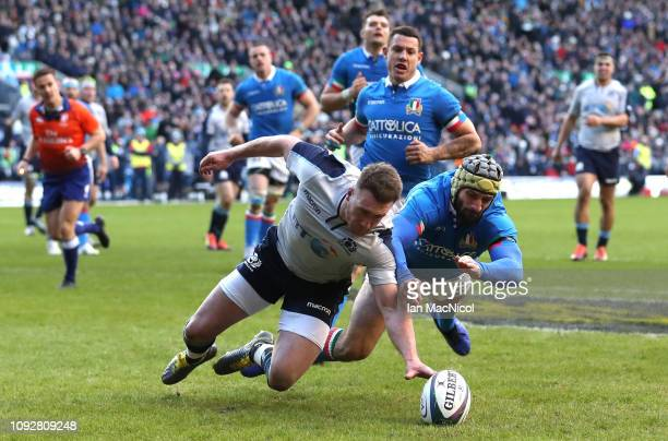 Stuart Hogg of Scotland scores his sides third try during the Guinness Six Nations match between Scotland and Italy at Murrayfield on February 2 2019...