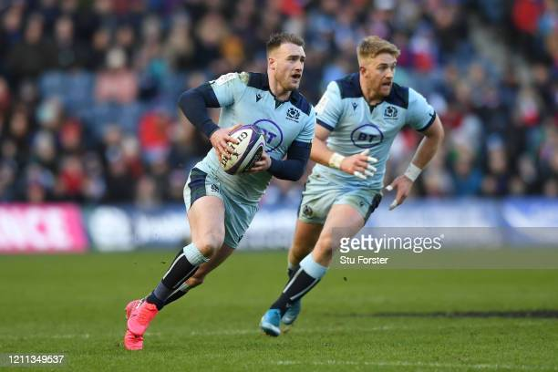 Stuart Hogg of Scotland weaves his way up field supported by Kyle Steyn during the 2020 Guinness Six Nations match between Scotland and France at...