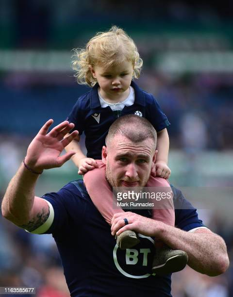 Stuart Hogg of Scotland with his daughter Olivia at the final whistle during the Summer Test match between Scotland and France at Murrayfield Stadium...