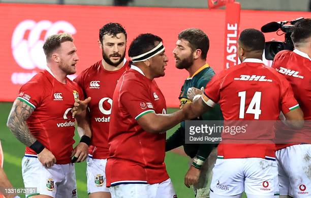 Stuart Hogg of the Lions argues with Springbok full back Willie le Roux during the 2nd test match between South Africa Springboks and the British &...