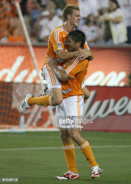 Stuart Holden celebrates Brian Ching's goal of the Houston Dynamo against goalie Bouna Coundoul of the Colorado Rapids on May 10, 2008 at Robertson...