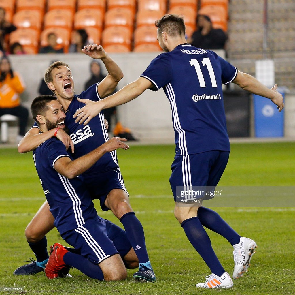 Stuart Holden celebrates with Clint Dempsey after he scored on a bicycle style kick during the Kick In For Houston Charity Soccer Match at BBVA Compass Stadium on December 16, 2017 in Houston, Texas.